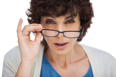 http://www.dreamstime.com/stock-image-portrait-shocked-woman-looking-over-her-glasses-white-background-image31240081